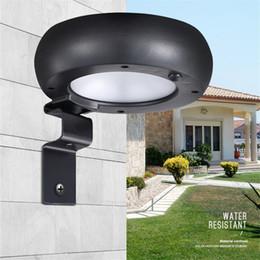 Wholesale solar black light led - mini 6 LED Sensor Solar Powered Light Outdoor Lamp Wall lamp Garden lighting light Control microwave sensor round black shell