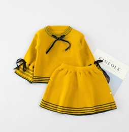 Wholesale Girls Sweater Skirt Sets - Girls knited sweater siuts 2018 spring new children round collar lace-up Bows long sleeve tops+stripe skirt 2pcs sets red pink mustard R2222