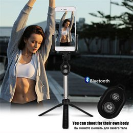 Wholesale phone stuck - Handheld mini Tripod Phone selfie stick Bluetooth Shutter Remote Controller Foldable Wireless for iPhone Selfie Stick Free Shipping
