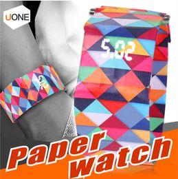 Reloj de papel digital online-Reloj de papel digital Venta caliente Moda Pulsera magnética Deporte casual Reloj LED Reloj impermeable Tyvek Correa de papel Regalos para niños Chidren