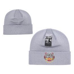 666f0a3894f 2018 Top designer Brand Gold Tiger head logo style beanies for Women Men  Canada Goosess beanie Pom Pom Knitted cap Hats FREE SHIPPING DHL