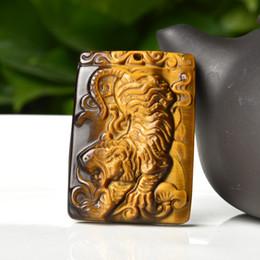 Pendente intagliato dell'occhio della tigre online-Ciondolo tigre intagliato a mano della tigre della gemma dell'occhio della tigre 100% naturale dei commerci all'ingrosso + collana libera Pendente fortunato dell'oro in oro con la corda