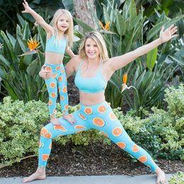 2019 pantalon mère fille Fils de mère fille correspondant 2pcs / set vêtements Tops + pantalon citron Leggings maman et moi sport Yoga famille Look Beachwear tenues promotion pantalon mère fille