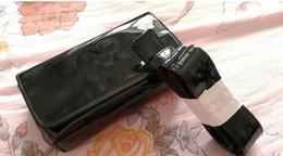 Sacs de rangement pour manteaux en Ligne-2018 Nouveau classique motif noir PU manteau peinture sac 20 cm femmes taille sac avec célèbre logo cosmétique maquillage boîte de rangement VIP cadeau sac