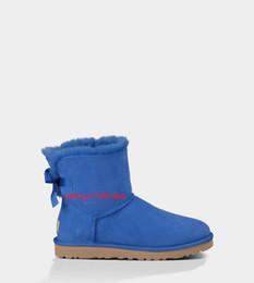 Botas de piel azul online-Botas de nieve para mujer de invierno real Volver con zapatos con nudo de lazo Moda de piel de lana azul negro Moda clásica sexy botas adolescentes activas