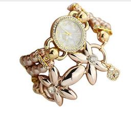 Überlegene quarzuhren online-Saatleri 2018 Superior Modeschmuck Frauen Uhr Luxus Perlenarmband Quarz Armbanduhr Relogio Femme Blume Reloj Mujer