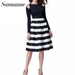 Samuume Vintage faldas plisadas de rayas en color blanco y negro de las  mujeres 2017 falda midi de cintura alta elástica Saia Faldas A1506008 8f758b84badf