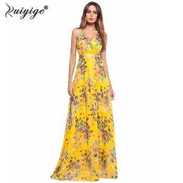vestido amarillo con tiras Rebajas 2018 Ruiyige estampado floral amarillo vestido de tiras de gasa con cuello en V profundo Sexy Backless mujeres estilo Boho vestidos de playa de verano Vestidos