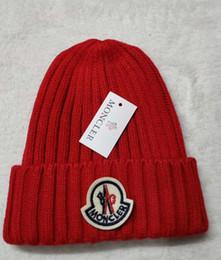 Sombreros de diseño de invierno online-Unisex Polo invierno tejer gorrita tejida hombres y mujeres de punto sombreros calientes cráneos diseño de marca de moda al aire libre gorras envío gratis