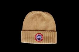 Cappelli invernali moda canadese per uomo donna 100% lana Skullies cappello donna cappelli in lana d'oca casual caldo berretto a maglia da parrucche per i colori delle donne fornitori