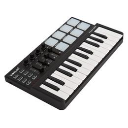 Almohadilla de piano online-venta al por mayor Panda mini portátil Mini 25 teclas USB teclado y controlador MIDI Drum Pad