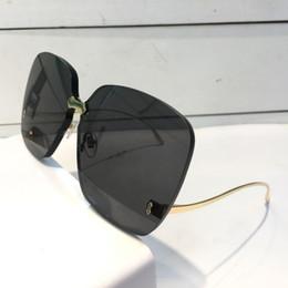 Lunettes de soleil rectangulaires sans cadre en Ligne-Luxe 0352 Designer lunettes de soleil pour femmes Mode lunettes de soleil Wrap Lunettes De Soleil Sans Cadre Revêtement Miroir Lentille En Fiber De Carbone Jambes D'été Style