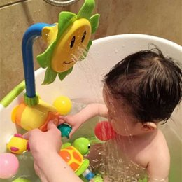 Wholesale Manual Toys - Baby shower toy sunflower sprinkler manual child baby water bath and swimming toy safety dabble