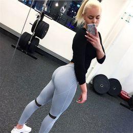 Le nuove donne dimagriscono lo yoga Pantaloni tuta pantaloni elastici laterali traspiranti ginocchio pieghettato pantaloni fitness da