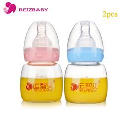 Wholesale Mini Drinking Glasses - REIZBABY 2pcs lot 60ml Baby Bottle Nipple Cover Free of Handle Glass Juice Water Drinking Mini Bottle Self Feeding Milk