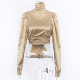 ad6fa8e22a78 Sexy Lace Up Bow Silk Satin Blouse Women Gold Puff Sleeve Turtleneck Shirt  Blusas 2018 Backless Party Crop Top Streetwear