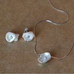 Conjuntos de perlas puras online-2018 el último estilo Collar de perlas puras irregulares La verdadera cadena de plata esterlina 925 Conjunto de perlas Pendiente y collar Conjunto de joyas Joya fina