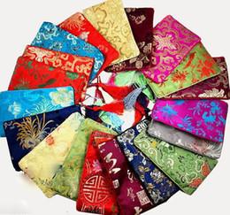 Bolso de seda hecho a mano chino online-Comercio al por mayor 10 unids / lote bolso de regalo de la bolsa de la joyería hecha a mano clásica china del monedero del teléfono chino