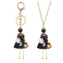 Wholesale Necklace Flowers - 2018 Cute Flower Dress Doll Necklace Pendants Jewelry New Fashion Kids Pendant Key Chains Bag Charms Accessories For Women Christmas Gifts