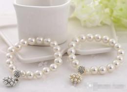 Wholesale Fashion Jewelry Charms - Luxury fashion designer Pearl Beaded Bracelet Bridal Charm jewelry for women lady girl beautiful Elastic bracelet lovely wedding jewellry