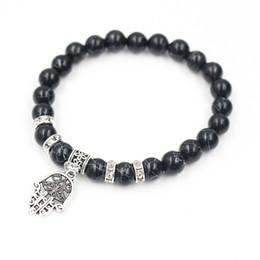 Venta al por mayor 8 mm blanco natural Howlite negro Onyx grano de piedra budista Buda colgante encanto meditación oración grano pulsera Mala desde fabricantes