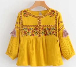 Manches longues de style de la mode des femmes en bas cols broderie fleurs gland conception chemisier élégant dame blouse livraison gratuite ? partir de fabricateur
