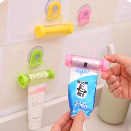 Preguiçoso Toothpaste Dispenser Toothbrush Titulares De Plástico Rolando Tubo Espremedor Útil Toothpaste Fácil Dispenser Titular Do Banheiro Frete Grátis supplier plastic toothpaste tubes de Fornecedores de tubos de dentes de dentes plásticos
