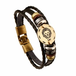 Pulseras de aleación de bronce de moda del zodiaco Pulsera de pulsera de cuero punk Bolas de madera del hematita negro Encanto Charm JewelryZI-147 desde fabricantes
