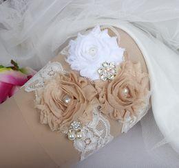 Ligas de novia Perlas de diamantes de imitación Cuentas de cristal Flores de champán Encaje para las ligas de boda de la novia Ligas Tallas grandes Fábrica WholeSeller desde fabricantes