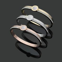 channel 18 2018 - Wholesale of Titanium Bracelet White Shell licensing round, single row drill Snake Bracelet 18 K Gold Bracelet