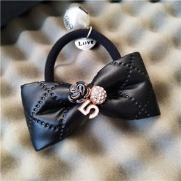 Perla simple pelo de la perla anillo del pelo bowknot cuerda de la cuerda barra de cuero colgante retro Adornos para el pelo coreano contador regalos desde fabricantes
