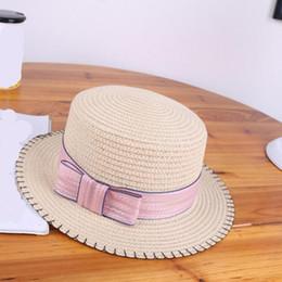 2017 donne estate paglia piatta sole cappelli ragazze BowKnot viaggio  spiaggia cappelli protezione femminile uv cappelli chapeau femme f9626a844e11