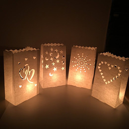 Wholesale wedding lanterns candle holder - Creative Paper Candle Bags Christmas Wedding Party Table Centrepiece Candles Holder DIY Manual Hollow Out Lantern Decoration 0 65zb YY