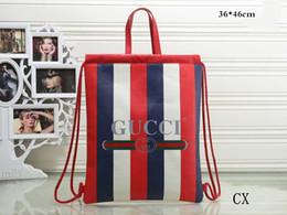 Bolsas azuis brancas on-line-Famosa marca designer mochila moda bolsas de luxo saco de compras azul branco split mix lona grande capacidade saco de compras