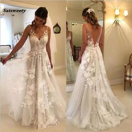 vestidos brancos de mão cheia Desconto Vestido de noiva de praia 2019 vestidos de noiva a linha de tule com decote em v de renda sem costas Dubai árabe Boho vestido de casamento vestidos de noiva