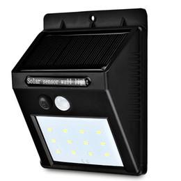 Sensores de movimento pir sem fio ao ar livre on-line-Lâmpadas solares 12LED Movido A Energia Solar Sem Fio PIR Sensor de Luz Ao Ar Livre Jardim Gramado Paisagem Quintal luzes Lâmpadas de Parede de Segurança