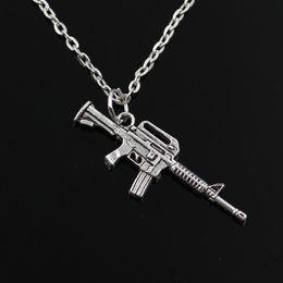 Wholesale Womens Silver Long Necklaces - whole salenew fashion machine gun assault rifle Pendants round cross chain short long Mens Womens silver necklace Jewelry Gift