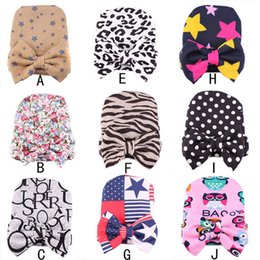 Wholesale favor bows - Christmas Parent-child Beanie Cap Warm Baby Knitted Embroidery Striped Bow Cap Hats Party Favor Gifts WX9-207