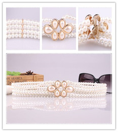 4a27b3ff481c Nueva señora de la manera las mujeres cintura elástica cadena de decoración  cinturón de la perla de la flor falda de cintura Cintos fiesta de diseño de  lujo ...