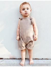 Maglietta felpata bambino online-New Summer Baby Boys Girls T-Shirt senza maniche in cotone con maniche corte Tute in cotone neonato Kaki Tute Z11