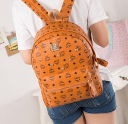 Wholesale American Style School Bags - Summer new fashion punk rivets backpack school bag neutral backpack student ladies and men travel backpack, campus student backpack