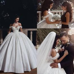 e3c1eb39a3 2019 simples vestidos de boda de satén hinchado 2019 Nuevo árabe fuera del  hombro vestido de
