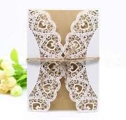 sigilli di nozze di nozze Sconti 5 in 1 White Hollow Rustico Laser Cut Inviti di nozze Fidanzamento Matrimonio Grazie biglietto di auguri con nastro di tela Busta tag guarnizioni