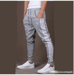 Venta al por mayor-Men Joggers Joggings Pantalones Slim Skinny Pants Harem Pantalones Casual Hip-Hop Pantants Homme Envío Gratis desde fabricantes