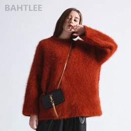 3ccecbd78fb6 venta al por mayor 2018 suéter de punto de mujer angora de invierno suéter  O-cuello de visón manga de mariposa de cachemira muy gruesa mantener  caliente ...