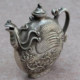 Te tibet online-CHINA de colección decorado antiguo trabajo hecho a mano Tíbet de plata tallado Phoenix Tea Pot