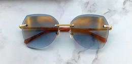 Wholesale crystal decorative - New fashion designer sunglasses Ca irregular frameless crystal cutting lens light summer high-end decorative eyewear top quality