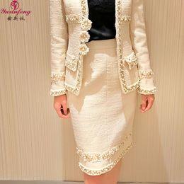 Saia de senhora de escritório on-line-Yuxinfeng Outono Inverno Pesado Pérolas Frisado Tweed Saia Mulheres Moda Runway Designer Saias Senhora Escritório Lápis Saia Branco