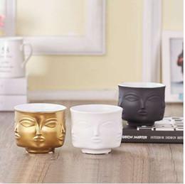 2019 florero de cerámica blanca Face Shape Designs Jarrón de cerámica Porcelana Flower Pot Decoración del hogar Accesorios Jardineras Golden Black White Tools rebajas florero de cerámica blanca