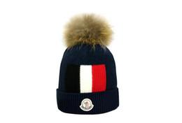 Gorro de lana negro online-Canadá gorrita tejida hombres gorro de lana casual de punto gorra de esquí gorro negro gris azul rojo de alta calidad cráneo tapas